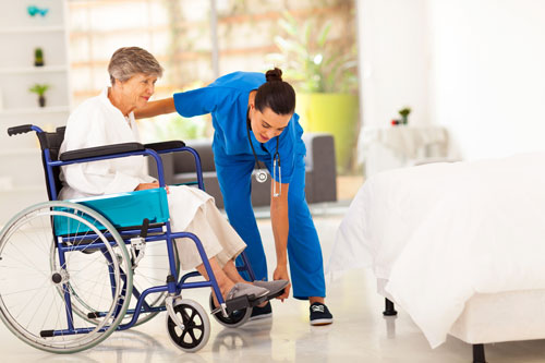 Caregiver helping an Elderly