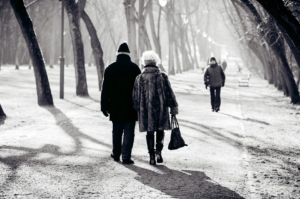 elderly couple walking down Miami path during winter